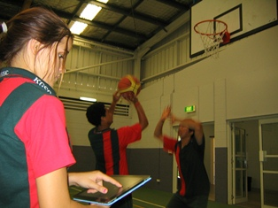 Students playing indoor sports.